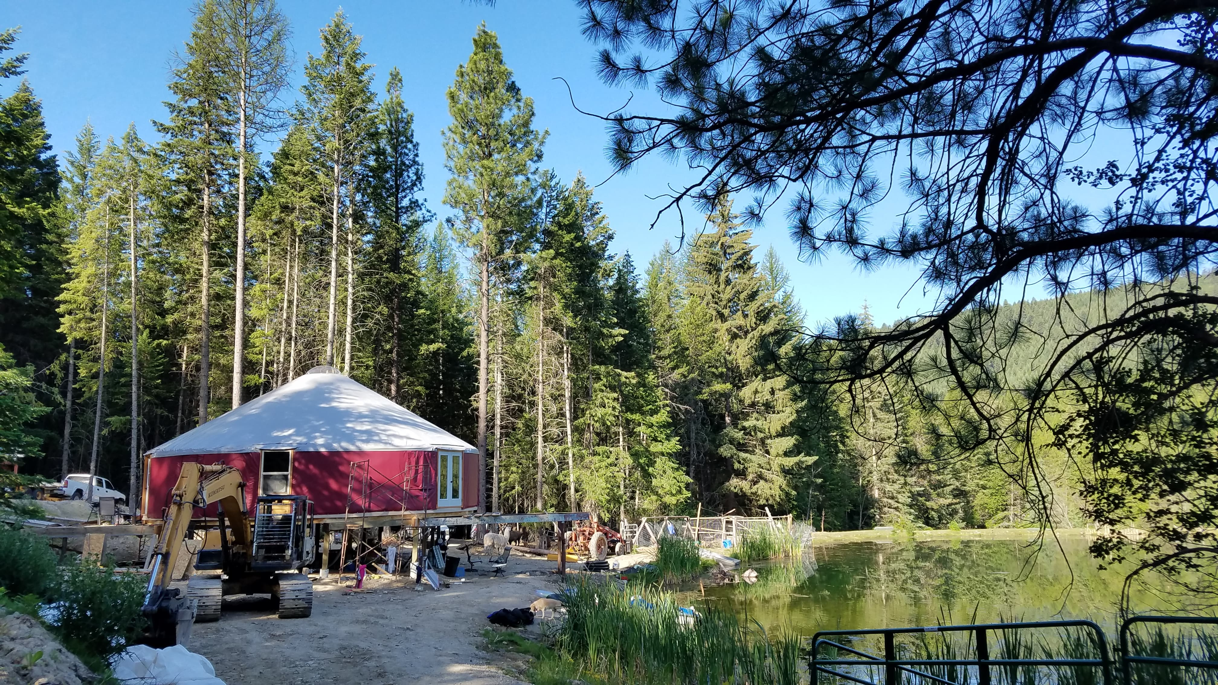 red 40 foot shelter designs yurt on a pond