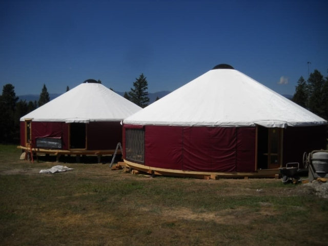 2 red shelter designs yurt with white roofs